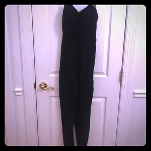 Bebe size 4 all black dressy jumpsuit with pockets